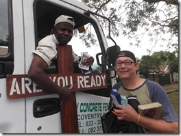 Malawian Osten poses with his Christian literature and KJB New Testament