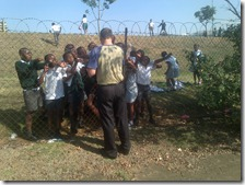 Gary handing out Gospel cards at Piet Retief Primary School