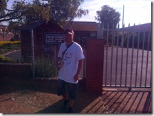 Marius outside Piet Retief Primary School