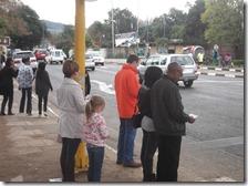 Reading Gospel literature at the pedestrian crossing