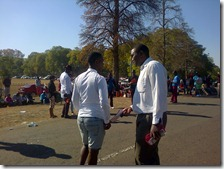 Lungisa persuading a man to take literature