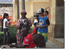 Grandson Cee-Jay tracting souls and the old African man on the steps