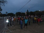 Fans milling around as night falls
