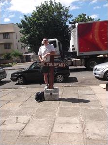 "Gary preaching atop ""The Box"""