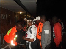 Spectators being searched before entering the stadium