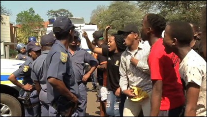 Protesting students confronting SAPS' Law Enforcement Officers