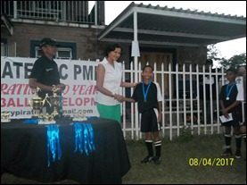 My grandson Cee-Jay receiving his medal  with Curt to the right