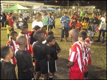 Pirates lining up to receive their medals watched by Soccer kids Academy
