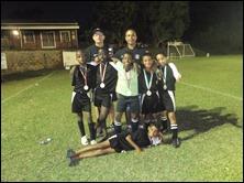 Back Row: Gary Crous (Asst. Coach), Miles Rogers (Head Coach). Front Row: Thando Hlophe, 'Kofi' Atta, Azande Zondi, Malachi Momplé, Cee-Jay Mulder. Laying: Curt Rogers.
