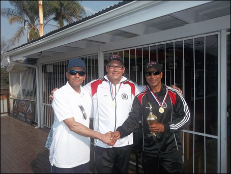The M.D.F.A. and Pirates F.C. Chairman George Carelse with the Pirates F.C. Under 10 Coaches Gary Crous (Asst.) and Miles Rogers (Head) after receiving the League Champions Trophy