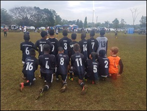 The M.D.F.A. U10s showing off their squad numbers