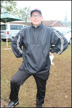 Assistant Coach Gary Crous in the rain