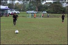 Curt Rogers taking a free kick . . .