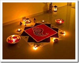 Rangoli decorations , made using coloured powder or sand, are popular during Diwali.